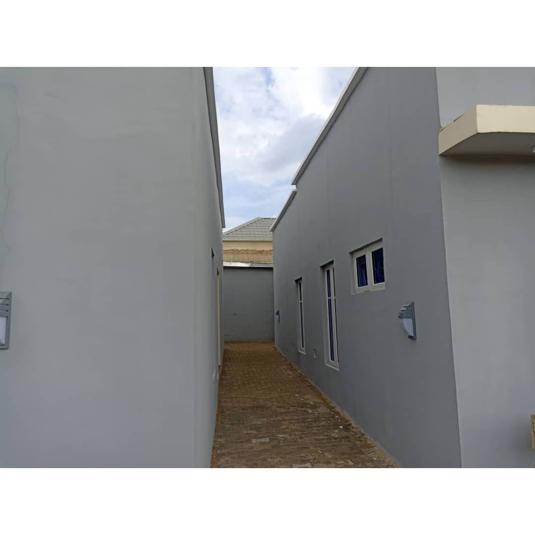 Three bedroom flat with a security house 77