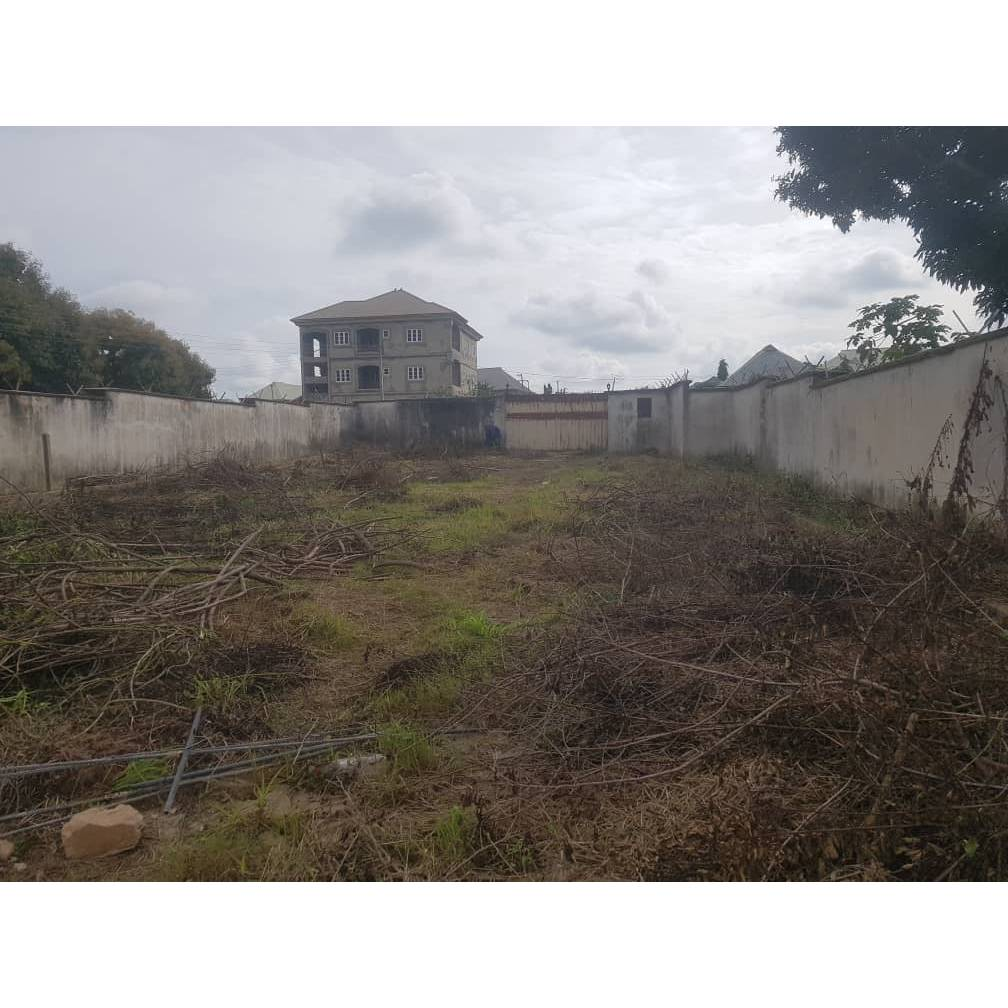 25plot of land fully fenced with German floor & covered by C of O 94